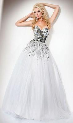 "Jovani Dress 159499 JO-159499  Style: JO-159499  Name: Jovani Dress 159499  Closure: Zipper  Details: Gradient Sequins on Skirt  Fabric: Tulle  Length: Floor  Neckline: Strapless Sweetheart  Waistline: Empire"""
