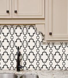 Traditional doesn't have to mean stodgy. Sometimes it just means classic. You can't go wrong with a pattern like Tyles Agadir in Black -- in any room, any home or office.