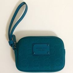 """! Michael Kors blue neoprene wristlet Good used condition. Small wristlet, approximately 4""""x5.25"""". Small marks on the back shown in picture #3. Blue neoprene small wristlet with wrist strap. Inside is clean. 100% authentic- code GS-1208. Some small scratches on nameplate and a small stain on the front shown in picture #2. Top zipper. No additional pockets inside. MK logo on the outside neoprene and on inside wall. Price is firm No trades Michael Kors Bags Clutches & Wristlets"""