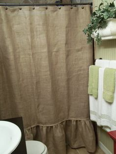 No crazy about the ruffles, but the burlap is nice. Ruffled Bottom Burlap Shower Curtain by SimplyFrenchMarket on Etsy - also have burlap curtain panels