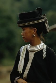 Laos | The Hmong women pride themselves on their headgear | ©W.E. Garrett