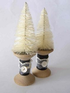 Bottle brush trees and vintage spools. Right out of the 40's with a modern flair!