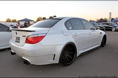 BMW ///M5.....this is one to have...black rims compliments white body.... awesome