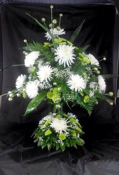 Green and white, center piece for St.Patricks day. Cute floral arrangement for the tables! ©Naples Flowers