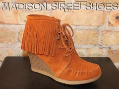 Minnetonka Lace Up Fringe Ankle Wedge Boot in Brown