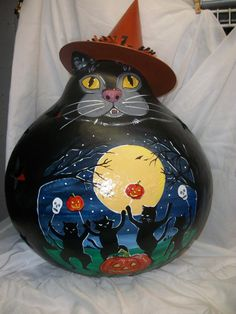2013 Lighted Cat gourd with handpainted scene. Hand painted, carved and crafted from a huge dried gourd. Carved stars are illuminated when light by a furnished 7 watt clip light. by Carolyn Lockwood - Hebron, OH