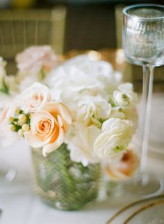 I like the combination of hydrangea, ranunculus and soft peach roses  Omaha Country Club Wedding Inspiration Shoot    Read more - http://www.stylemepretty.com/little-black-book-blog/2013/12/30/omaha-country-club-wedding-inspiration-shoot/