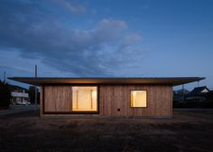 A large roof overhangs the walls of this simple wooden house on Japan's Kanto Plain.