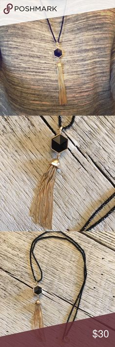 Banana Republic Black Onyx Tassel Necklace Banana Republic Black Onyx Tassel Necklace. Received as gift and just haven't worn it. Excellent, like new condition. Cleaning my jewelry box, pricing to sell! Banana Republic Jewelry Necklaces