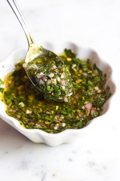 A zesty chimichurri recipe made with fresh herbs, garlic and vinegar that you can use 100 different ways.