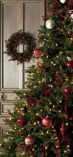 Christmas tree and wreath against paneling