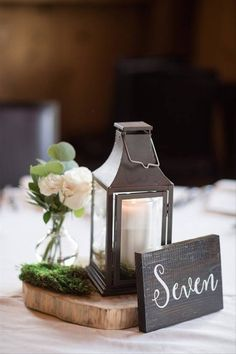 30 Rustic Wedding Centerpieces That Go Beyond the Basic Mason Jar - Yes, it IS possible to have a rustic wedding without mason jars — trust us. Say hello to these stylish rustic wedding centerpieces that are anything but overdone. lantern flowers roses table number fall