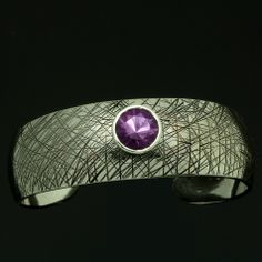 Omega cuff in sterling shown set with amethyst also available in clear quartz, smokey quartz, citrine and champagne quartz! Compromise? NO, WEAR ART!