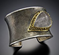 "Cuff | Jeff and Susan Wise. ""Super JuJu"".  Oxidized sterling silver with brookite crystal from Brazil, set in 18k gold"