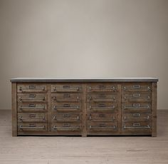 Early 20th C. zinc-top mercantile sideboard from Restoration Hardware. How's that for a file cabinet?
