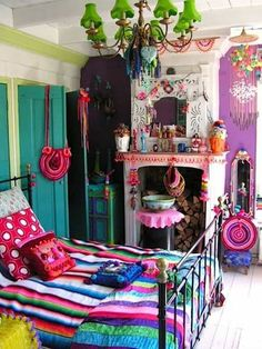 Bedroom , Adorable Boho Chic Bedroom : Boho Chic Bedroom With Chandelier And Colorfull Knick Knacks And Mirror Over Mantel And Striped Bedding