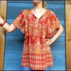 Bohemian Blouse Bohemian Blouse, loose fitting, chiffon like material with slip, orange and red fabric, buttons on chest with hang down ties, never worn! Apt. 9 Tops Blouses