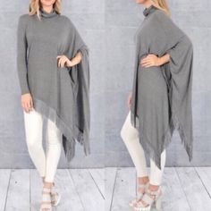 NEWThe SAMIRA asym fringe poncho top - GREY Two colors available: BLACK & GREY. How fun is this turtle neck long sleeve asymmetrical fringe top? Light enough to start wearing now, but can transition to fall & winter. NO TRADE Tops Tees - Long Sleeve