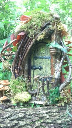 Fairy door is made from a wooden store bought white balsa wood doll house door. It makes for a sturdy light weight base, it has a hook on the back you Mini Fairy Garden, Fairy Garden Houses, Gnome Garden, Garden Crafts, Garden Projects, Garden Terrarium, Succulent Planters, Hanging Planters, Succulents Garden