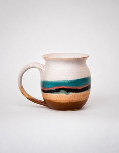 These handmade ceramic tumblers are artfully crafted by a husband and wife team. Made of stoneware clay and hand thrown on the wheel, the tumblers are glazed with a warm soft white, creamy in texture,