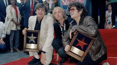 Phil Everly, Tom Petty, Don Everly   Rocker Tom Petty poses with the Everly Brothers, who got a star on the Hollywood Walk of Fame on Oct. 2, 1986. From left: Phil Everly, Petty and Don Everly.