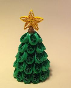 Here is miniature Quilled Christmas Tree. This little tree comes complete with its own traditional Star topper. There are 51 pieces quilled and