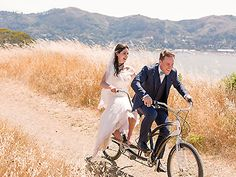 The newlyweds on a bicycle built for two | Juniper Spring Photography