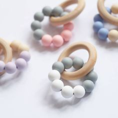 I've just found Silicone Beaded Wooden Teething Ring. A sweet little wooden teething toy to sooth sore comes.. £6.00