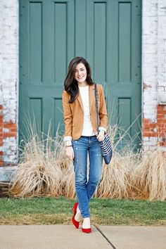 Blazer and jeans by J.Crew, shirt by Tory Burch, shoes by Carolina Espinosa, bag by Kate Spade. (January 25, 2014)