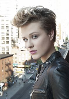 Evan Rachel Wood - Iove how she pomp'd her hair as it started to grow out. Badassery. This windswept view gives a better look at how it was cut.