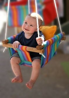 Weeeeeeee!  Sometimes wait a few seconds before you push the swing, and help your baby to say 'weeeee'.