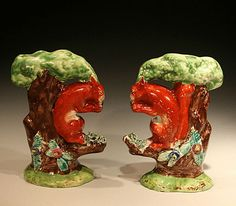 ANTIQUE STAFFORDSHIRE POTTERY FIGURES OF SQUIRRELLS C1820