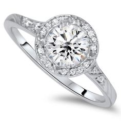 Hey, I found this really awesome Etsy listing at https://www.etsy.com/listing/154684396/100ct-halo-round-diamond-engagement-ring