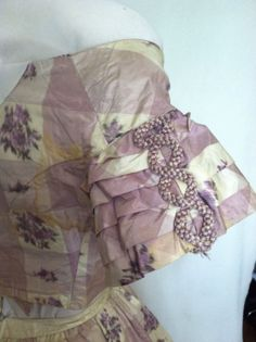 Lovely Civil War Era Lilac Silk Gown with Two Bodices   eBay seller heatherhock, skirt, day bodice, evening or young woman's bodice,  belt; lilac plaid with warp print, skirt - flounce at bottom  buttons; hand  machine stitching; day bodice - front hook  eye closure; evening - back hook  eye closure, sleeve tucks  cording; Medici belt has hook  eye closure; altered at later date to make it larger