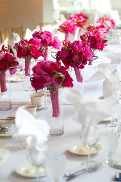 bright pink bridal party bouquets designed by tina barrera photographed by jon fedele