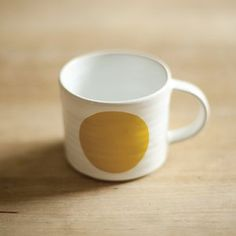 Wonderful hand thrown cup in stoneware clay, glazed in a white glaze and decorated with screen printed ceramic decals.
