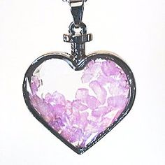 "A stunning new way to wear natural crystals and gemstones. Our Rose Quartz Heart Pendant Necklace is strung on a 20"" Sterling Silver chain necklace, and features Genuine Rose Quartz gemstone chips in a heart shaped prism cut glass with a silver plated frame.  Rose Quartz – Brings Love, Compassion, Happiness, Self- Love, and Emotional Healing.  Pendant size approx.  1.25"" x 1.5"" 20"" Sterling Silver chain necklace  Packaged in a pretty black Organza bag great for gifting."