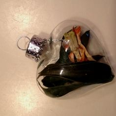 Mother of the bride or groom's corsage dried into a heart shaped glass ordament ! Adorable