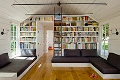 """540sqft home for 4. Recycled 4 times with reclaimed materials. Has a moss roof. And yes, that is the """"master bedroom"""" above the bookwall."""
