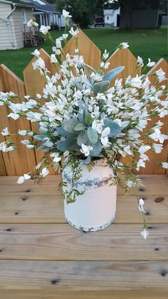 White wildflowers, lambs ear and rustic… Farmhouse table arrangement/centerpiece. White wildflowers, lambs ear and rustic greenery in Table Centerpieces For Home, Centerpiece Decorations, Kitchen Centerpiece, Centerpiece Wedding, Decoration Shabby, Farmhouse Table Decor, Rustic Table, White Farmhouse, Modern Farmhouse