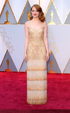 Emma Stone from Oscars 2017: Best Dressed Women  And the Academy Award for best dressed women goes to...all the leading ladies in this gallery!Starting with Emma and her gilded, vintage-inspired Givenchy haute couture number. Just the movement alone is worthy of an award.