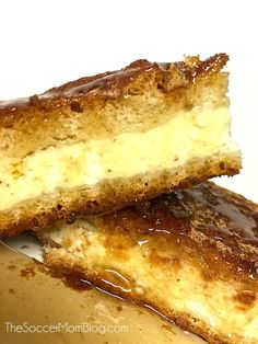 These Sopapilla Cheesecake Bars are the REAL DEAL!! Light and fluffy, luscious and creamy - REAL cheesecake sandwiched between layers of cinnamon-y sopapilla and drizzled with honey. You will LOVE this recipe!