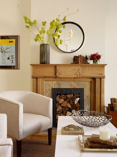 mantel - oak - marble hearth - round mirror - greens - books - love the mix of warm woods with modern mirror