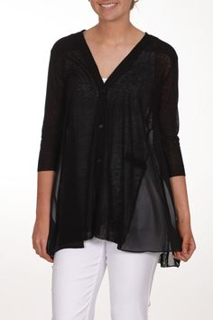 Great black knit cardigan with sheer panel details. Has 3/4 length sleeves and buttons going down the front. Falls below the waist and will look great with a pair of jeans or slacks.  Black Knit Cardigan by Parkhurst. Clothing - Sweaters - Cardigans Iowa