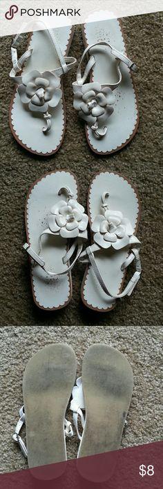 Gap Kids White Flower Sandals Gap Kids white flower sandals with adjustable strap. Patent leather style. Definitely signs of wear but still have life left in them. Slight wedge heel. GAP Shoes Sandals & Flip Flops