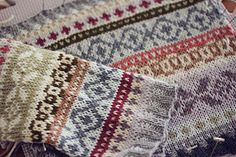 A straight tubular cuff worked in bands of Fair Isle colour-work. There are other examples of this same pattern using different colors. Looks completely different and beautiful.