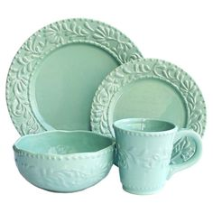 Bring a charming touch to your tablescape with this lovely earthenware dinnerware set, featuring a scrolled detailing and scalloped rims.