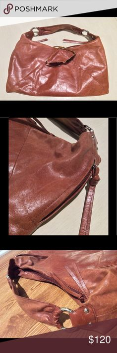 Hobo International Whiskey Purse Authentic & Like new, used once, genuine leather, leather tassel zipper pulls, 6 inside compartments, 2 outside side zipper side pockets, and 1 inside zipper. Measures 17x9 inches. Beautiful bag Hobo International Bags Hobos