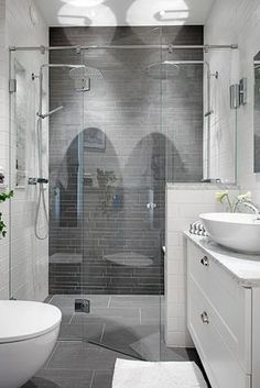 *Great small bathroom. double shower heads. want it! Love the style sink allows for a full drawer under.