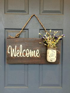 As friends, family, and strangers approach your home you want them to be imbued with warmth, excitement, and most importantly acceptance. This rustic wooden sign captures those positive emotions by combining the country chic styles of distressed wood with a Mason jar vase. The purchase